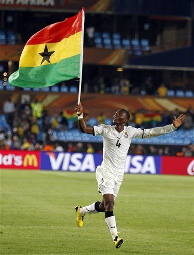 Holding Ghana flag after victory